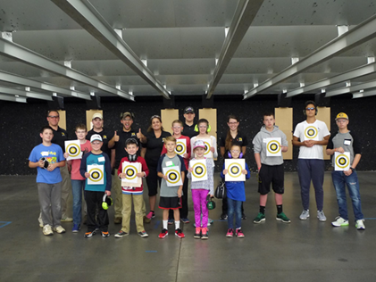 Youth class holding up targets